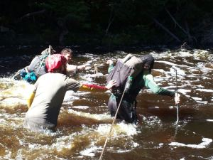 Fording a river in Maine. It was chest deep at one point.